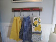 haha, cute idea--pastry cutters fastened to a board to create a place to hang all those dishtowels!
