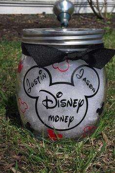 Personalized jar for your vacation savings.  Disney inspired. Mickey heads. $15.00, via Etsy.