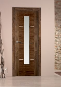 Como door in Walnut fitted with square section matching Walnut frame, architrave and skirting set.