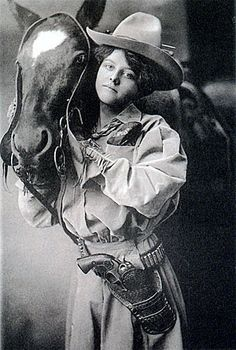Lucille Mulhall ... famously known as the first cowgirl.  Born in the saddle, she was the spirited daughter of an Oklahoma rancher.  Unlike her sisters, she wasnt interested in dolls and sewing or piano lessons but preferred branding yearlings and roping wolves, jack-rabbits and steers; training ponies; and practicing the trick riding that was to make her famous all over the country.  Teddy Roosevelt was among Lucilles fans.