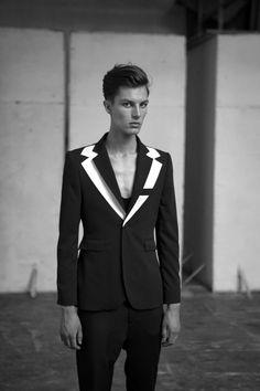 Sandor Lakatos Fall/Winter 2013... Men's black and white double lapel blazer.