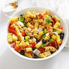 This colorful antipasto salad is a tasty crowd-pleaser. Guests love the homemade dressing, which is a nice change from bottled Italian. — Linda Harrington, Windham, New Hampshire