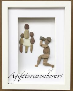 """The photographer"" another custom-made design! #agifttorememberart #pebbleart #giftideas #etsy #etsyseller #photographer #photography #frames #makersgonnamake #artwork #handmade #originaldesign #nature #stones #seaglass #family #unique #art #instaphoto #instaart #craft #roomdecor"