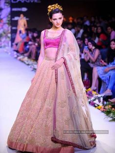 A model walks the ramp for Shyamal and Bhumika on Day 6 of the Lakme Fashion Week (LFW) Summer Resort 2014, held at Grand Hyatt, Mumbai, on March 16, 2014. (BCCL/Tejas Kudtarkar)See more of : LFW '14: Shyamal & Bhumika