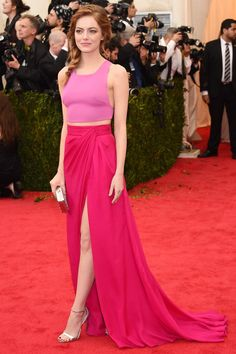Emma Stone at the Costume Institute Gala. She pulls this difficult ensemble off beautifully. And we're so glad she's back to red, it really is the best haircolour for her!
