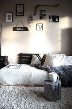 Love pallet on the wall where bed is