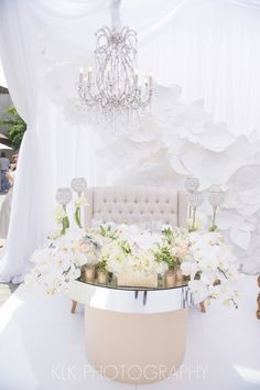 Allure Events Atelier   Booth for the 2013 Unveiled Orange County Bridal Show   Florals by Celio Designs   photographed by KLK Photography. We provided the paper flower wall, gold antique frame mirror, Paris love seat, Venice chair, London accent tables, Las Vegas dining tables and the chandeliers.