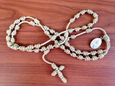 Tan / Beige Knotted Cord Rosary with Saint Andrew medal attached by georgiegirl83 on Etsy https://www.etsy.com/listing/193212460/tan-beige-knotted-cord-rosary-with-saint
