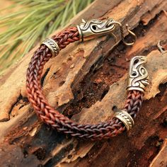 This is a genuine brown leather handmade braided bracelet with real solid bronze wolf heads and beads, with a clasp connector.  Wolves feature prominently in Celtic (especially Irish) mythology as well as other world mythologies. The Wolf or Madadh-alluidh symbolized cunning, an intelligent creature, capable of out-thinking hunters. It can teach you how to read the signs of Nature in everything, how to pass by danger invisibly, how to outwit those who wish you harm, and how to fight when…