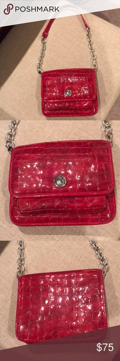 """Brighton red small handbag/ 5x6"""" wallet w/ handle Never used Beautiful red Brighton small handbag, also can be used as a wallet. Has detachable strap. Measures 5""""x 6"""". It will hold an iPhone 7 plus!!  Only reason I am parting with it is because I have 2 red wallets and my husband says I only need one!! Brighton Bags Wallets"""