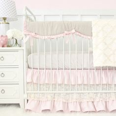 This 3 piece set features a taupe dot crib sheet & a gorgeous blush pink & ivory lace triple ruffle crib skirt and a vintage linen crib rail cover.