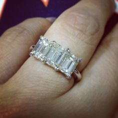 Emerald cut diamond trio ring.