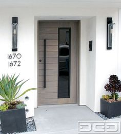 Modern entry door in solid white oak with modern pull handle and asymmetrical glass design by Dynamic Garage Door. Custom manufactured entry door systems for luxury homes in the San Francisco Bay Area. Call: (855) 343-3667 for project cost inquiries.