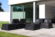 In- and outdoor lounge chair and table/pouf made of PE. Easy to stack and easy to move around as it is so lightweight.