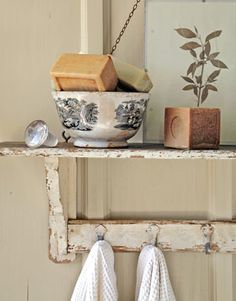 Near the tub, an old shelf suspended by a chain displays toiletries.    Read more: Home Renovation - 19th Century House - Texas Hill Country Home - Country Living