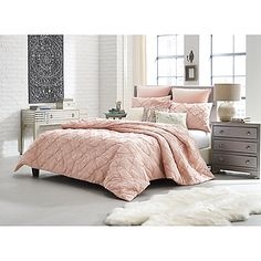 Chic and trendy, the Anthology Mina Comforter Set will brighten your space with its lovely style. An all-over pintucked design offers a soft, sophisticated look and is complete with coordinating pillow shams to transform your bedroom from drab to fab.