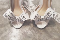"Close up.  Celest Thoi bespoke bridal shoes with Swarovski crystal. 3"" with leather lining   # wedding heels design bow ribbon off white lace crystal blings"
