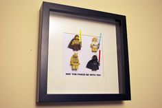 What a great Idea for a Christmas/birthday present.. I don't think my son would leave them in the frame however!!! lol Lego Star Wars  minifigures frame