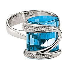 Gadi Blue Topaz Ring  SKU: T-3239    Designer Jewelry by Gadi: Blue Topaz Ring. 8 Kt white Gold with custom cut Blue Topaz as Center Stone.This ring has brilliant colors and the gem stones get custom cut to match your size.