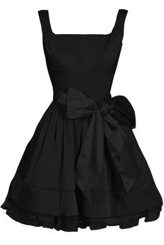 Short black dress, with the top cut low! One of my faveorites, especially with the bow!