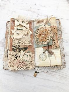 This listing is for a lovely three piece set that can be used together or separately * one standard size travelers notebook hard-cover with four elastic bands to house your standard tns. Made from chipboard, covered with papers, inks, paints and some mixed media elements. The altered metal