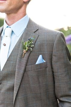 Groom in three piece light grey suit with pale blue check from Gresham Blake | Succulent Buttonhole | Pale Blue Pocket square | African Theme Wedding | Rustic Barn Wedding | Image by Anushé Low | http://www.rockmywedding.co.uk/marisa-edward/