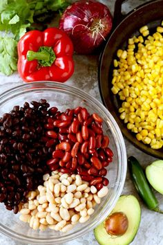 Ingredients to make bean salad on a marble surface. #food #recipes #veganrecipes #healthyliving #fitnesstips