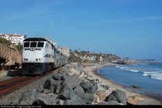 A Metrolink commuter train heads north on the Pacific Surfline as it hugs the beaches of southern California.