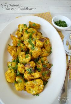 Get the health benefits of turmeric and a delicious side dish with this easy roasted cauliflower recipe
