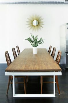 Sarah + Rupert on Design Sponge [i love everything about this home] - sunburst mirror over dining room table.