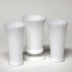 $2 each  Assorted large milk glass vases.
