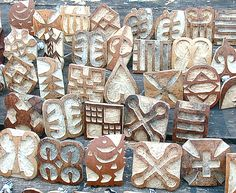 Adinkira stamps made from gourds. The West African symbols were a form of thought or conveyance used by pre-colonial Ghanaian people. Each symbol has a discrete but abstractive meaning. For a brief history and index of some symbol meanings, check out the website   http://www.adinkra.org/