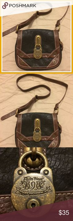 Nine West Blue & Brown Leather Crossbody Purse ***a piece of the caromarked, rags to riches collection!***  Nine West Blue & Brown Leather Crossbody Purse - Vintage America Collection  Only One In-Stock!  Condition: Super Trendy!!! Great Condition!  No Stains! No Scratches!  No Discoloration!  No Rips! No Tears! No Holes!  Details: Nine West Crossbody Purse - part of the Vintage America Collection Blue & Brown Leather Magnet Snap for closure  this item has been caromarked!... bid/buy now…