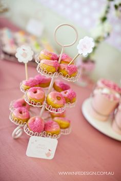 cute! pink frosted donuts displayed on cupcake stand. cute dessert idea for spring!