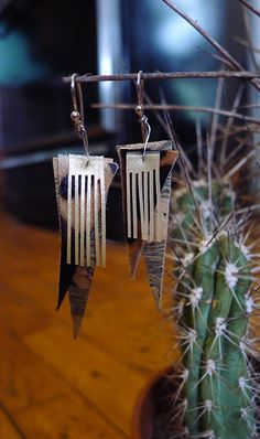 Hey, I found this really awesome Etsy listing at http://www.etsy.com/listing/157988673/brown-leather-fringe-earrings-made-with
