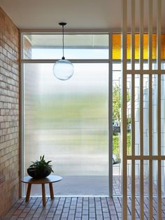 I think that this entrance gives good lighting because it allows a lot of natural light but the windows are tinted so that the room doesnt get too bright. Interior Architecture, Interior And Exterior, Mcm House, Entry Foyer, Door Entryway, House Entrance, Mid Century House, Mid Century Modern Design, Cool Lighting