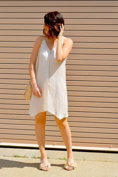 Styling a slip-dress for summer date night on Rosy Outlook! www.rosyoutlookblog.com slip-dress, blush, champagne, urban outfitters, sam edelman, mules, summer, occasion, dress, outfit