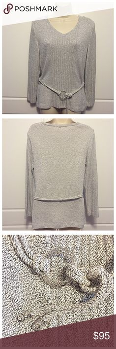 """St. John White & Silver Belted Sweater Sparkling white and silver ribbed V neck sweater has a braided belt with silver metallic loop and tips. Size tag is missing but measurements are: bust 17"""", length 25.25"""", sleeves 22"""". Fabric is: 52% rayon, 42% cotton, 6% polyester. St. John Sweaters V-Necks"""