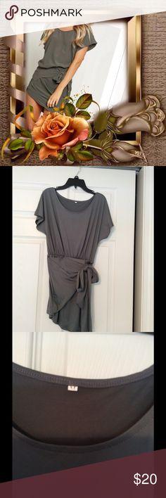 "Asymmetrical grey mini dress Asymmetrical grey mini dress, size medium but more like a small, 29"" from shoulder to hem, NWOT, very cute, polyester. Dresses Mini"