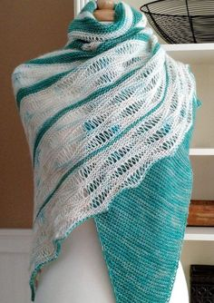 Knitting Pattern for Making Clouds Shawl - Alternating stripes of garter stitch and dropped stitches evoke a summer sky. Designed by lavenderhillknits