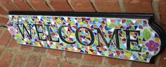 Mosaic Stained Glass Welcome Sign. $95.00, via Etsy.