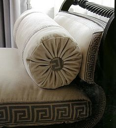 Greek Key Border on cushions, curved side and round bolster are lovely details.