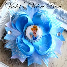 Cinderella Hair Bow- inspired by Cinderella - Boutique Hair Bow by Violet's Velvet Box. $8.99, via Etsy.
