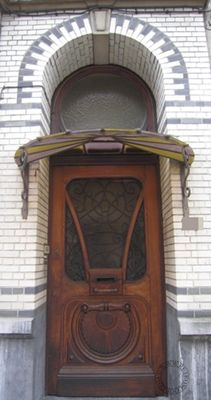 1930  lots of intricate carvings and details on both the door and the overhang