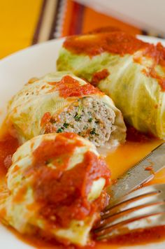 These lean stuffed cabbage rolls are filled with Italian flavored ground turkey, spinach and cheese, then topped with a tomato-y marinara.