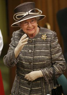 Queen Elizabeth II waves after the Inauguration Of The Tenth General Synod at Church House on November 24, 2015 in London, England.