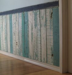"Beach Cottage Inspired Design Wainscoting-looks like ""distressed"" pallet planks."