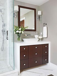 Clean lines bathroom: deep medicin chest for addl. storage. Flat paneled vanity wrapped in durable solid surfacing. Great shower.