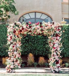wedding arch with tons of flowers