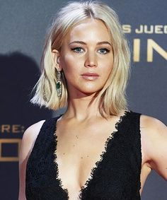 Jennifer Lawrence tips and falls on the red carpet — again. Maybe she really is just like us...